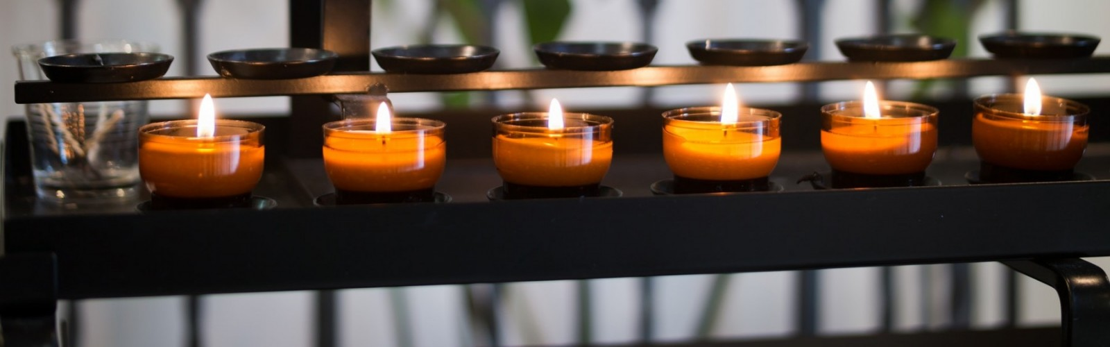 Tea lights on metal shelf - Unity in Frederick